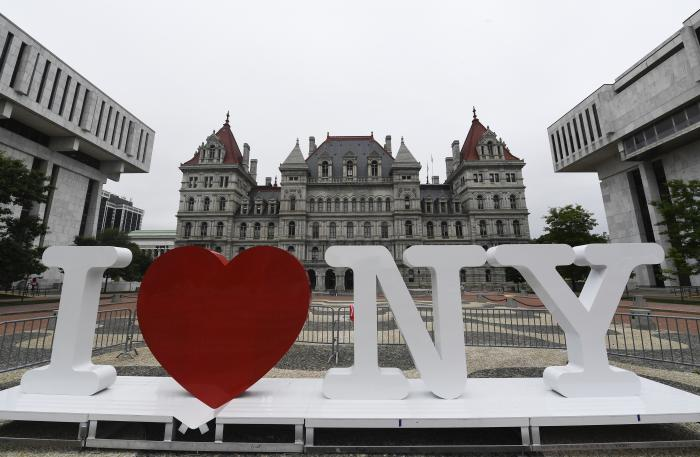 """A new promotional """"I Love NY"""" sign sits in the Empire State Plaza for installation in front of the New York state Capitol in Albany, N.Y."""