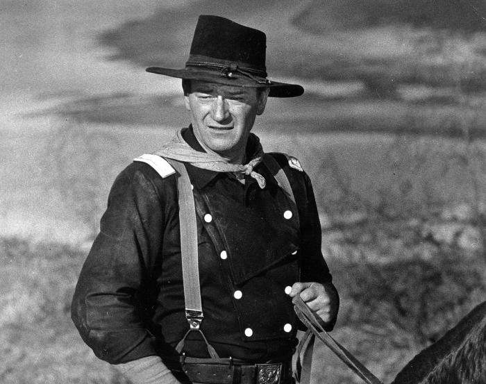 """John Wayne appears during the filming of """"The Horse Soldiers."""""""