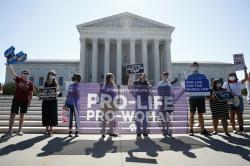 Anti-abortion protesters wait outside the Supreme Court for a decision, Monday, June 29, 2020 in Washington on the Louisiana case, Russo v. June Medical Services LLC.
