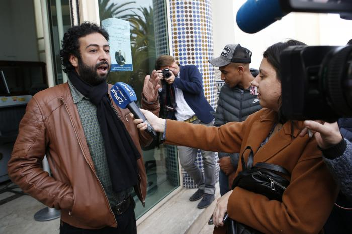 In this March 5, 2020 file photo, journalist and activist Omar Radi speaks after a hearing at the Casablanca Courthouse, In Casablanca, Morocco