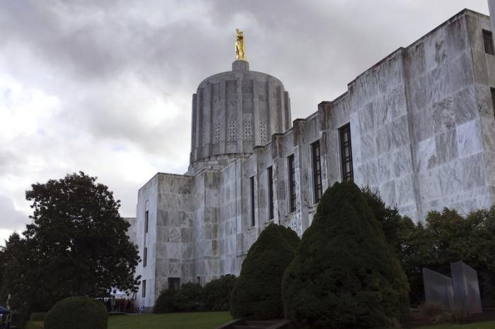 In this Jan. 11, 2018, file photo, clouds hover over the Oregon State Capitol in Salem, Ore.