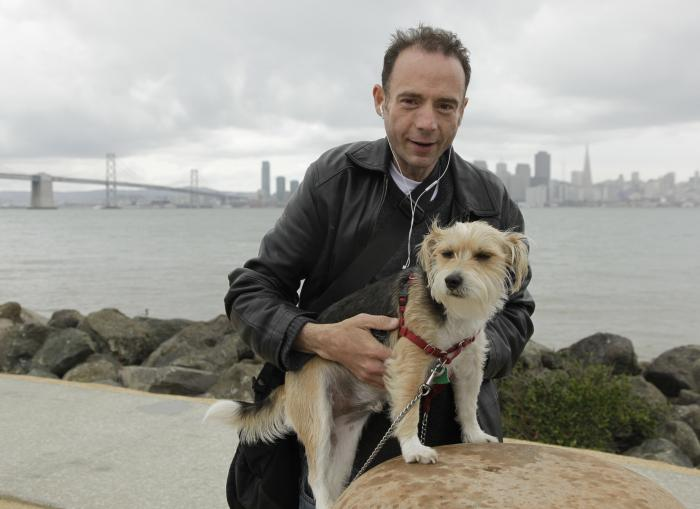 Timothy Ray Brown with his dog, Jack, on Treasure Island in San Francisco.