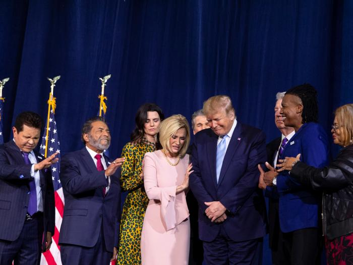 """In this Jan. 3, 2020 file photo, faith leaders pray over President Donald Trump during an """"Evangelicals for Trump Coalition Launch"""" at King Jesus International Ministry in Miami"""