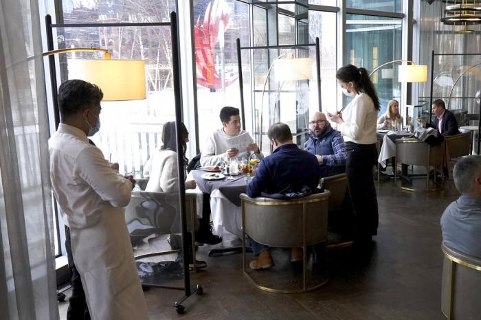 Patrons enjoy lunch indoors at Gibsons Italia restaurant in Chicago.