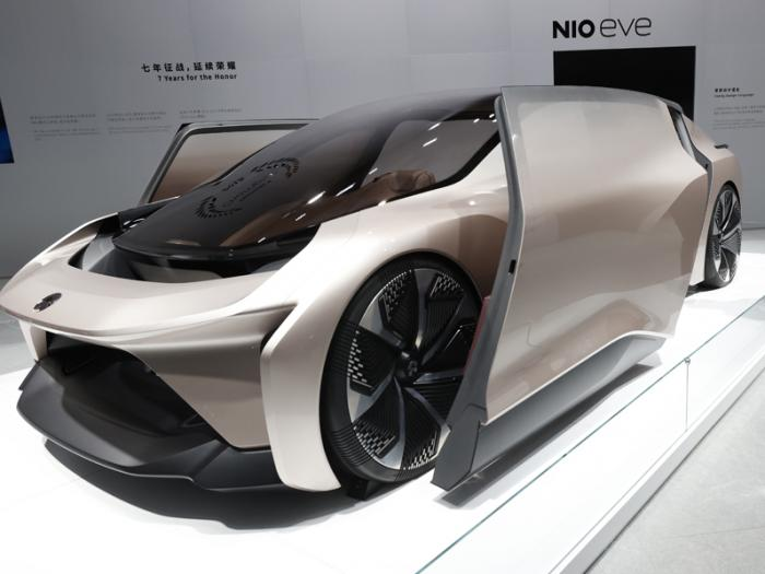 A visitor looks at the NIO eve concept car displayed during the Shanghai Auto Show in Shanghai on Monday, April 19, 2021