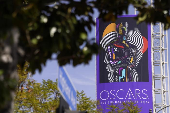 A sign advertising this year's Oscars ceremony is pictured near the Dolby Theatre, Thursday, April 15, 2021, in Los Angeles.