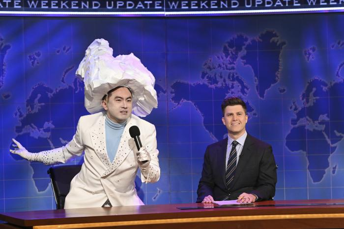 """Bowen Yang as The Iceberg That Sank The Titanic, left, and anchor Colin Jost during Weekend Update on """"Saturday Night Live."""""""